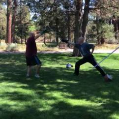 Alex Spreier of High Desert Armizare, and I demonstrating the parry of fifth against a cut to the head